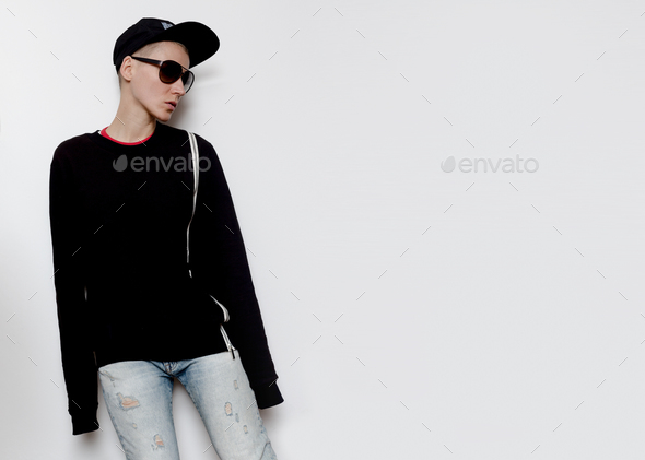 Tomboy Model Urban Outfit cap and Hoodie Fashion Trend - Stock Photo - Images