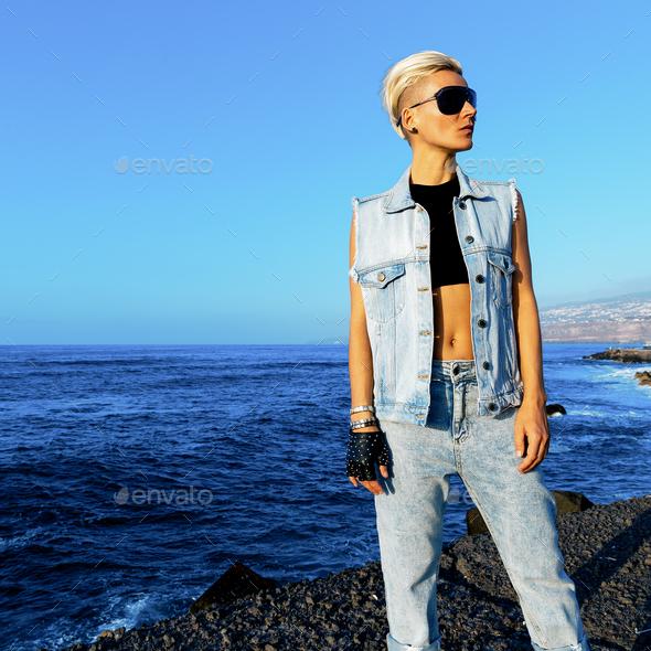 Stylish blonde in denim otffit on background ocean - Stock Photo - Images
