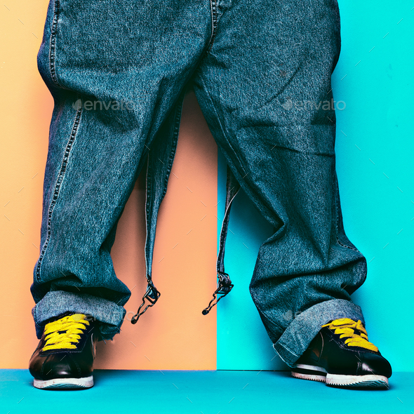 Stylish Jumpsuit. Urban Style. Sneakers and denim - Stock Photo - Images