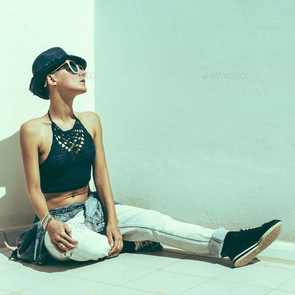 Woman traveler hipster a white wall. Relax Beach outfit fashion - Stock Photo - Images