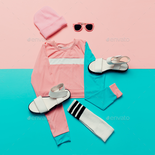 Stylish sports blouse and accessories. Sandals and sunglasses. T - Stock Photo - Images