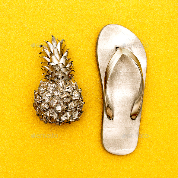 Minimal beach style. Pineapple and flip-flops - Stock Photo - Images
