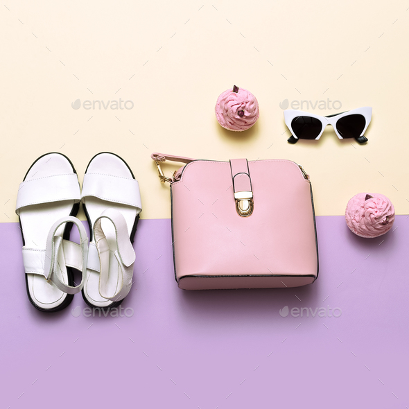 Ladies Fashion Accessories. Pink bag and sunglasses. Trendy sand - Stock Photo - Images