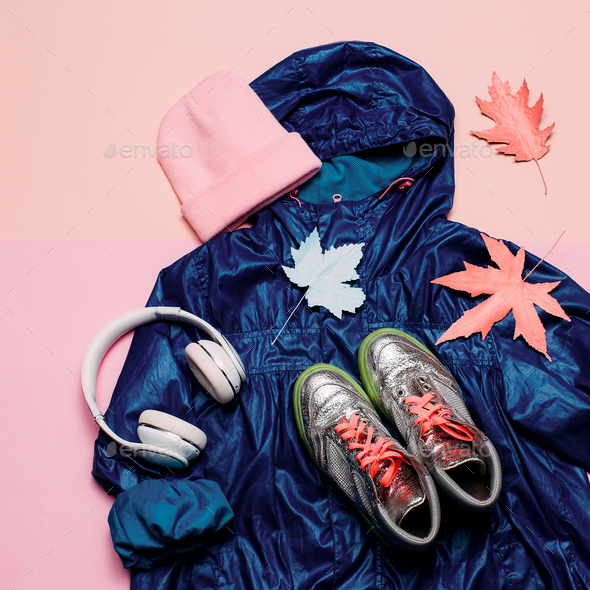 Cloak, Keds and Headphones Hi Rain Season. Urban street fashion. - Stock Photo - Images