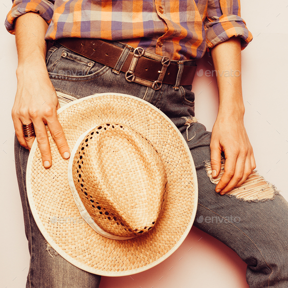 Country Cowboy style hat, jeans, plaid shirt - Stock Photo - Images