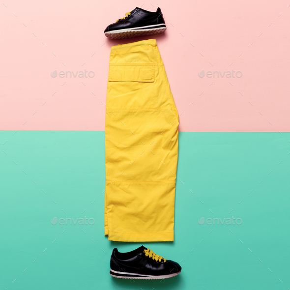 Minimal design. Pants and sneakers. Bright Summer Outfit - Stock Photo - Images
