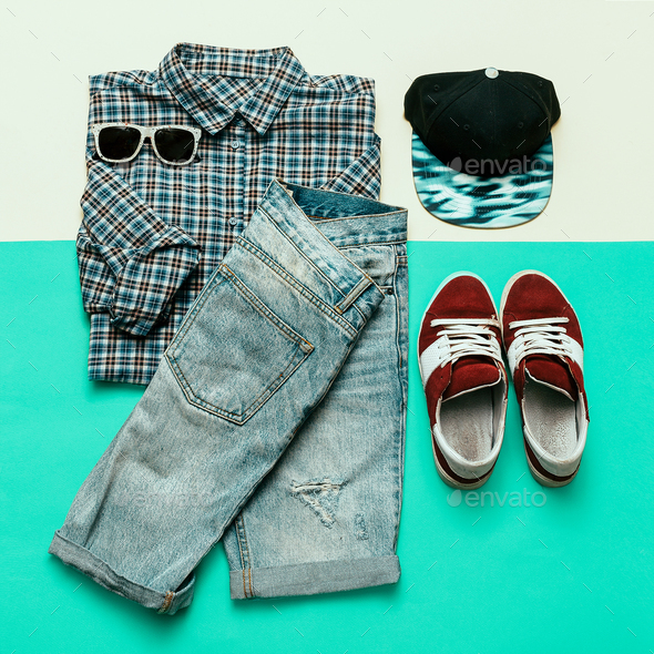 Urban clothing set. Plaid shirt, jeans, sneakers Skateboard styl - Stock Photo - Images
