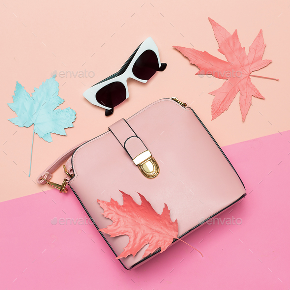 Fashionable Pink Bag and retro sunglasses for lady. Spring vibra - Stock Photo - Images