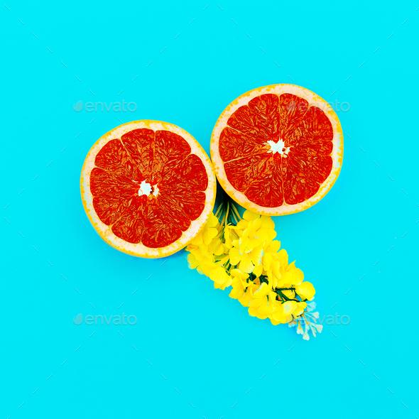 Grapefruit and Yellow Flowers Minimal art. Design - Stock Photo - Images