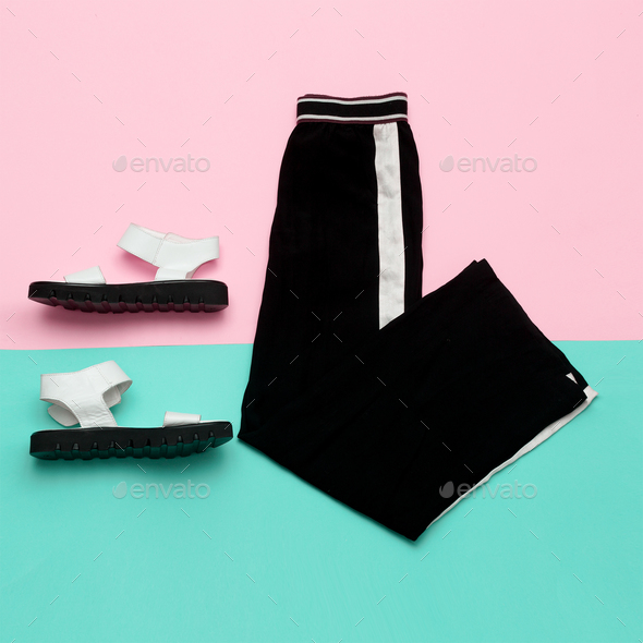Flat lay fashion set: white sandal shoes with and black pants wi - Stock Photo - Images