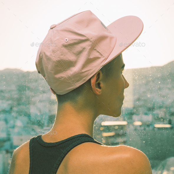 Girl in a stylish cap. Urban Street vibes - Stock Photo - Images