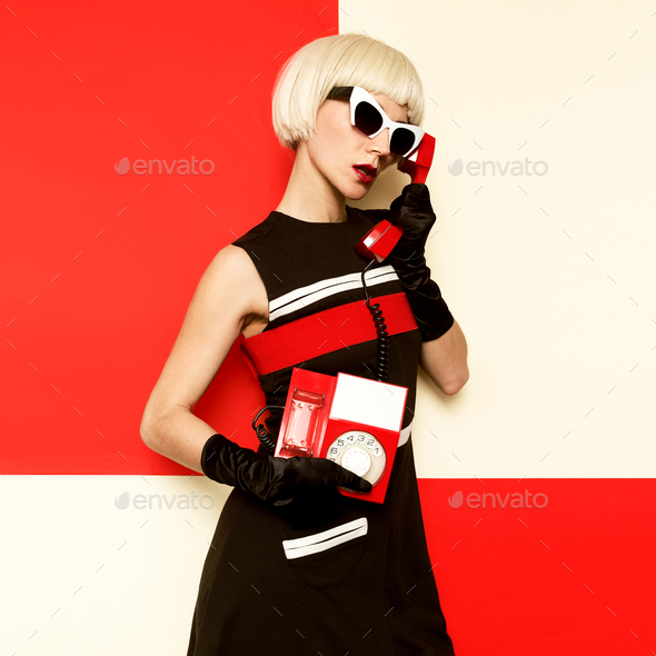 Elegant Retro Blonde in vintage clothes and retro telephone. Min - Stock Photo - Images