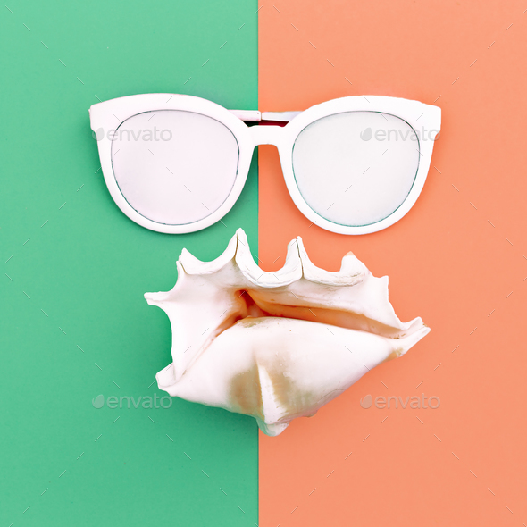 vacation time. Sea style. Shell and sunglasses Minimal art fashi - Stock Photo - Images