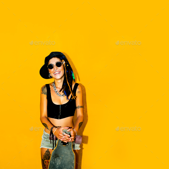 Fashion Rasta girl with dreadlocks and tattoos. Skateboard Stree - Stock Photo - Images