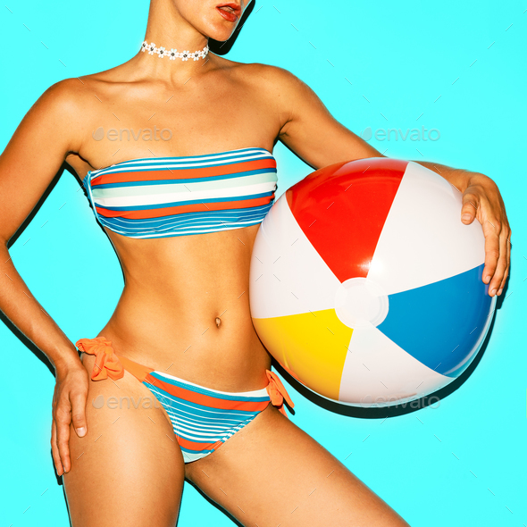 Tanned model in a fashionable swimsuit and with a beach ball. - Stock Photo - Images