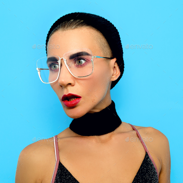 Tomboy Lady  in fashion glasses. Fashion accessory of the season - Stock Photo - Images