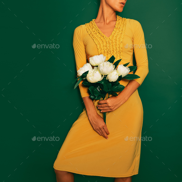 Model in vintage yellow dress. Retro style in detail - Stock Photo - Images
