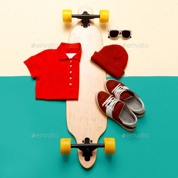 Skateboard set. Accessories. Jeans T-shirt sunglasses sneakers. - Stock Photo - Images