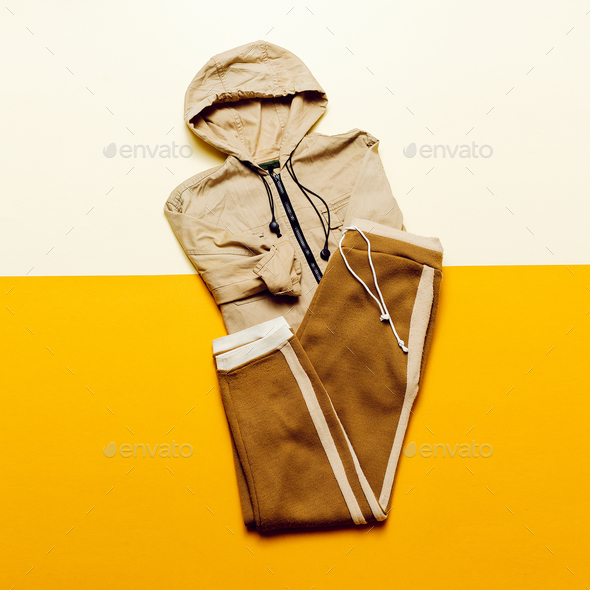 Urban Style Clothing. Skateboard fashion outfit. beige color tre - Stock Photo - Images
