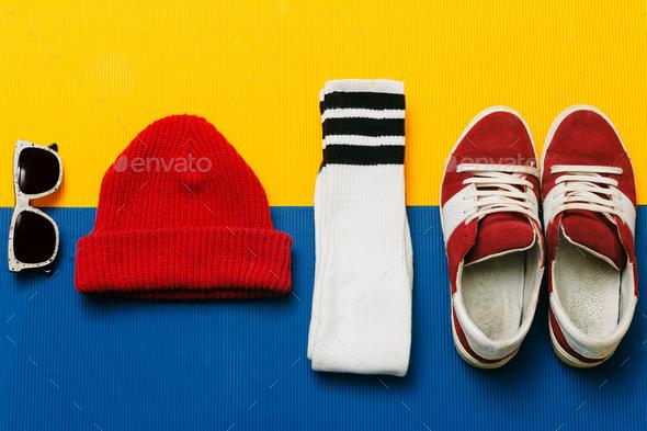 Sneakers, socks, cap, sunglasses. Fashion skateboarder set - Stock Photo - Images