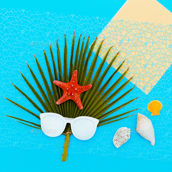 Fashion sunglasses and palm tree sea background Minimal art - Stock Photo - Images