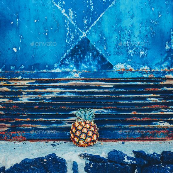 Mini pineapple on grunge wall background. Minimal style - Stock Photo - Images