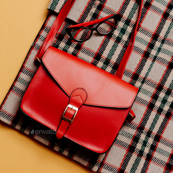 Checkered coat and red accessories. Red Bag. Fashion Trendy Urba - Stock Photo - Images