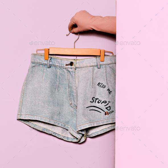 Stylish clothes. Minimal fashion. Denim Shorts Wardrobe Trends I - Stock Photo - Images