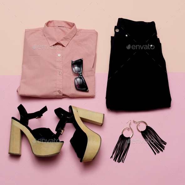 Stylish Lady Outfit pink shirt and black accessories - Stock Photo - Images