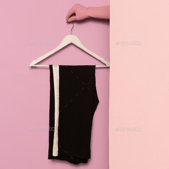Stylish clothes. Sports trousers. Strip print. Minimal fashion. - Stock Photo - Images