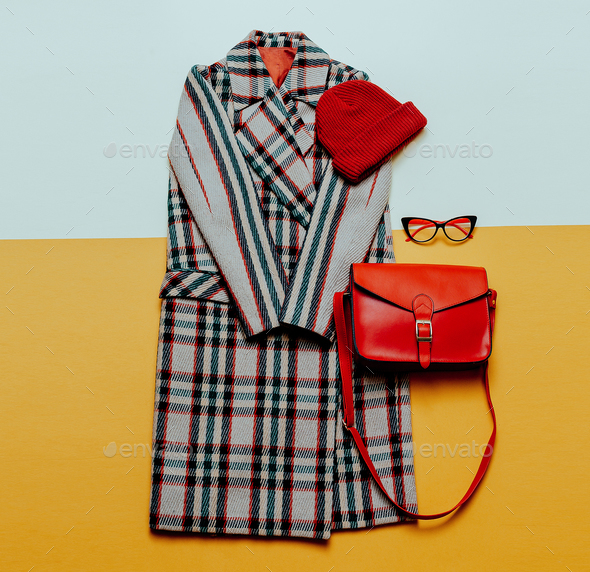 Checkered coat and red accessories. Urban Fashion Vintage Style - Stock Photo - Images