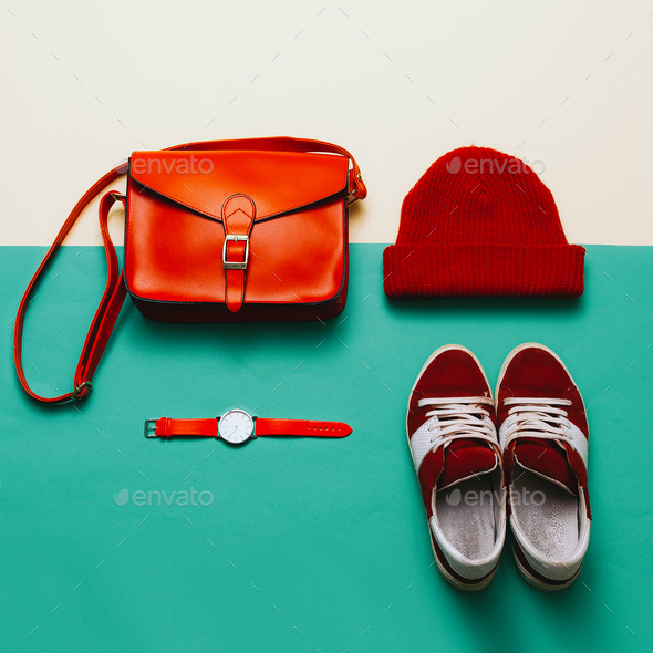 Stylish accessories and clothing. Focus on red. Handbags, caps, - Stock Photo - Images