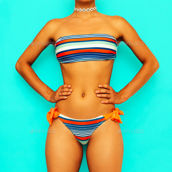 Girl in a striped swimsuit. Beach style fashion - Stock Photo - Images