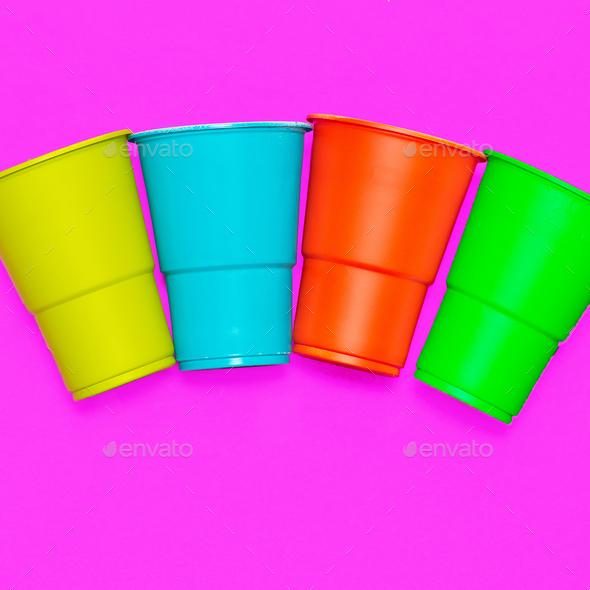 Plastic tableware. Minimal. Multicolored glasses - Stock Photo - Images