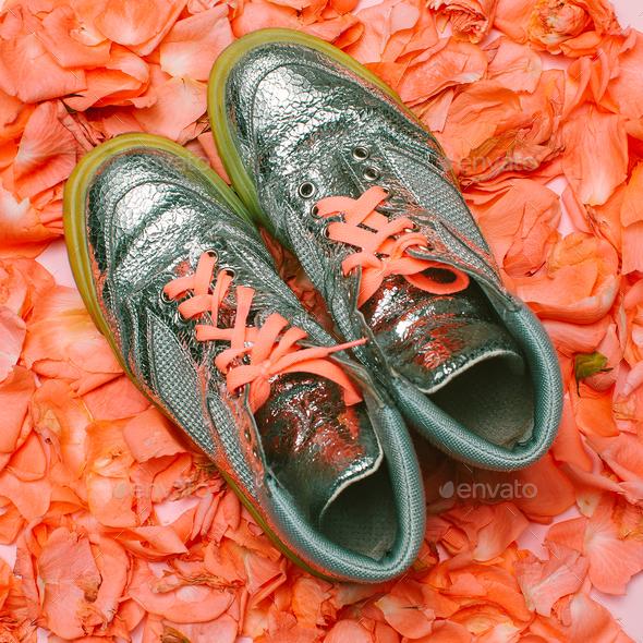 Minimal creative design. Glamorous shoes flowers background. Spr - Stock Photo - Images
