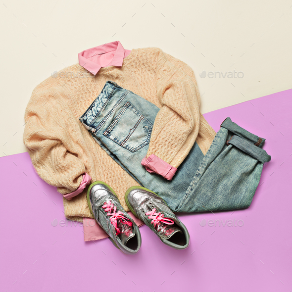 Ladies Fashion Clothes. Pink shirt, sweater and jeans. Glamorous - Stock Photo - Images