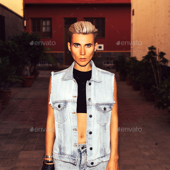 Tom Boy Model Stylish short hair and blue jeans Outfit fashion - Stock Photo - Images