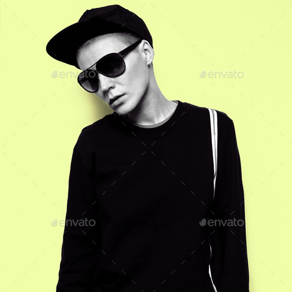 Tomboy Model Urban Outfit Hoodie cap and sunglasses Aviator Fash - Stock Photo - Images