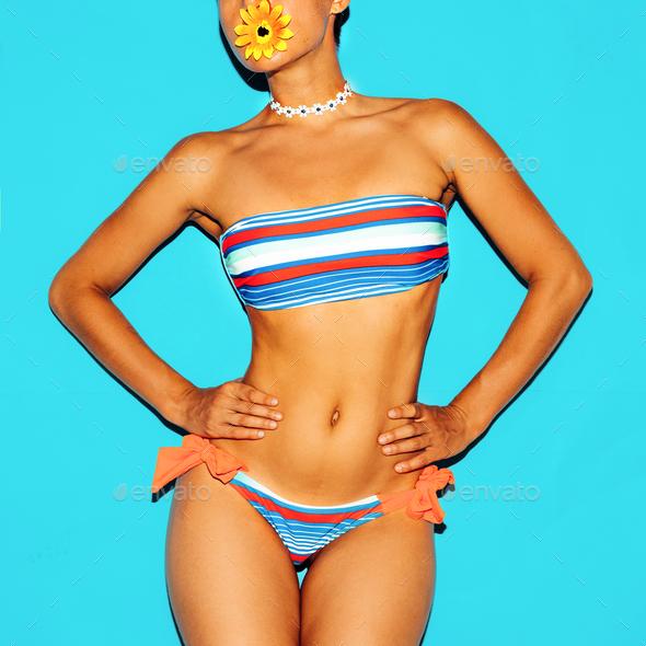 Beach Fashion Lady. Fashionable striped swimsuit. - Stock Photo - Images