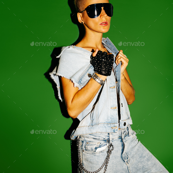 Model Tomboy stylish short hair and fashion jeans outfit. Cool s - Stock Photo - Images