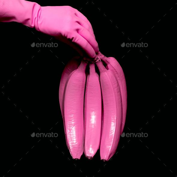 Pink Bananas holding hand. Surreal minimal art - Stock Photo - Images