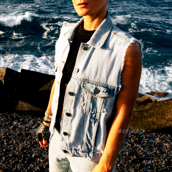 Stylish model in denim otffit on background ocean - Stock Photo - Images