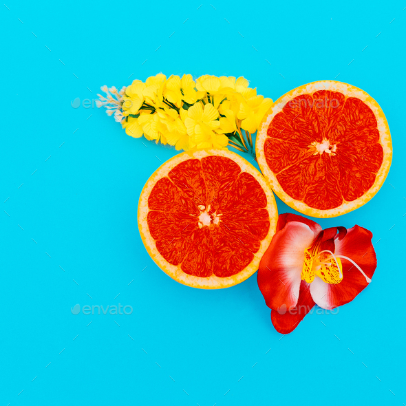 Grapefruit and Mixed Flowers Minimal art. Design - Stock Photo - Images