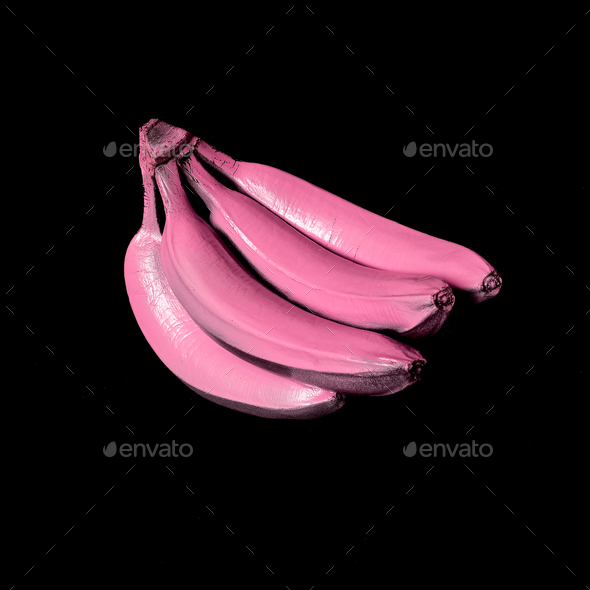 Bananas in pink paint on a black background. Surreal minimal art - Stock Photo - Images