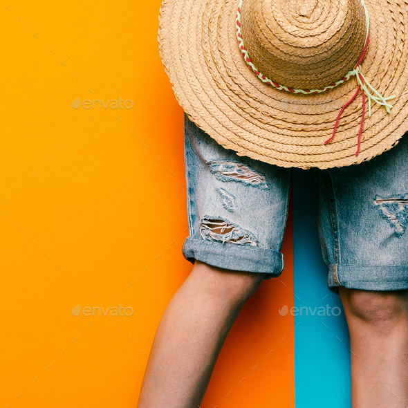 Denim shorts and straw hat. minimal style urban fashion - Stock Photo - Images