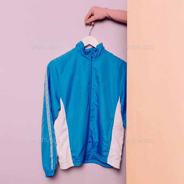 Stylish sportswear. Minimal fashion. Blue jacket on a hanger. Wa - Stock Photo - Images