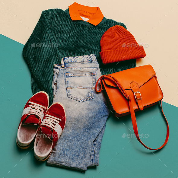 Stylish clothes. Focus on red. Caps, Sneakers, shorts. Bag. Acti - Stock Photo - Images