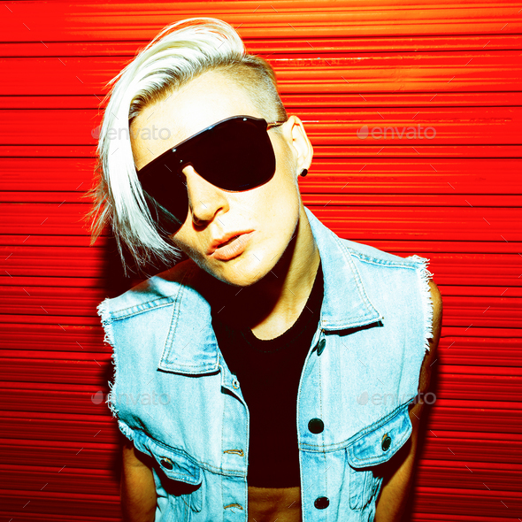 Blonde with short hair in stylish clothes and sunglasses on a re - Stock Photo - Images