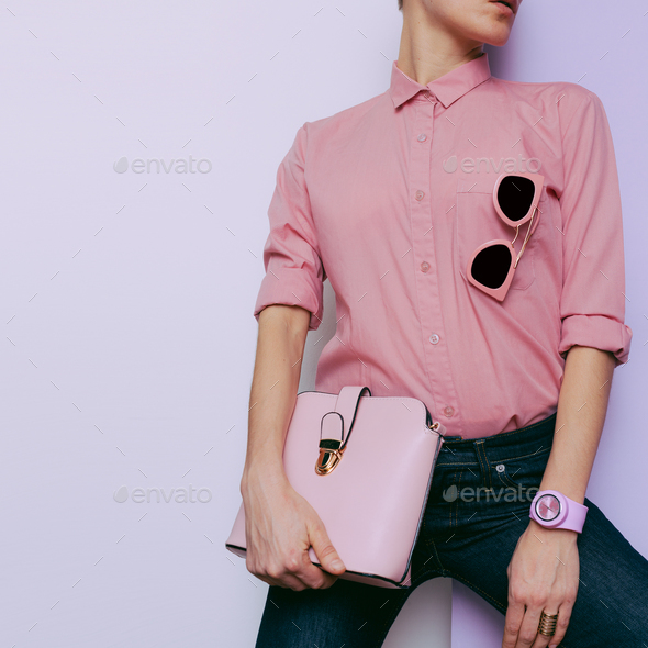 Girl in pink shirt and pink accessories. Watches, bags and sungl - Stock Photo - Images