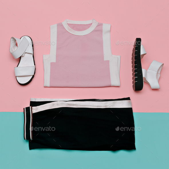 Flat lay fashion set: white sandals shoes, black striped trouser - Stock Photo - Images